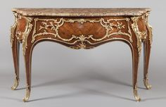 An Antique French Commode in the Louis XV Manner Attributed to J.E. Zwiener