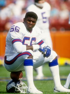 """Lawrence """"L."""" Taylor played his entire professional career with the New York Giants franchise as a linebacker, earning a widely held reputation as one of the greatest players in the history of the sport But Football, New York Giants Football, Football Hall Of Fame, Football Memes, School Football, Lawrence Taylor, Sports Stars, Sports Pics, Sports Figures"""