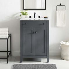 Description Embrace the subtle sleekness of the Brellin Bathroom Vanity. Brellin features crisp lines and a stately design that seamlessly updates your bathroom decor. Solidly constructed from wood and MDF particleboard, the Brellin Vanity sits on four tapered legs and provides hidden dual storage shelves with soft-close doors. Featuring a curved basin and 8-inch center set faucet holes, the Brellin Bathroom Vanity aligns style with function for a modern bathroom. Brellin comes with non-marking 24 Inch Bathroom Vanity, Small Bathroom Vanities, Bathroom Vanity Cabinets, Bathroom Furniture, Modern Bathroom, Bathroom Ideas, Small Bathroom Sink Cabinet, Basement Bathroom, Small Vanity Sink