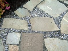 How to Create a Mosaic Patio: Using stone, pebbles, decomposed granite and dry mortar, you can build a patio surface that's uniquely yours.