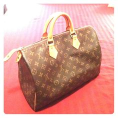 Louis Vuitton Speedy 35 Classic Louis Vuitton Speedy 35. I do not have the dust bag or the lock. There is normal wear/patina on handles. Some water marks on handles from getting caught in rain. No stains inside. Date code inside: mb1001. Any questions please ask. No trades, price is firm. Louis Vuitton Bags Satchels