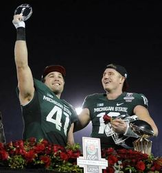 Kyler Elsworth and quarterback Connor Cook of the Michigan State Spartans, celebrate the Rose Bowl Championship after MSU's victory over Stanford in the 2014 Rose Bowl. Msu Football, Michigan State Football, Michigan State University, College Football, Thank You Poems For Teachers, School Is Over, High School, Msu Spartans, East Lansing
