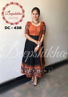 DC 438. Anarkali in kalamkari design with kalamkari border and hands with orange plain bodice. Anarkali top in orange and black combination with grey design all over the top with black bottom. For queries kindly WhatsApp : +91 9059683293 18 November 2017