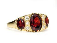 Homage in a Garnet & Diamond Ring