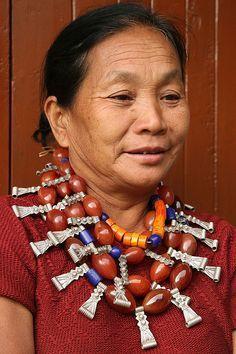 India Nagaland | Ao Naga woman at Ungma village by Walter Callens