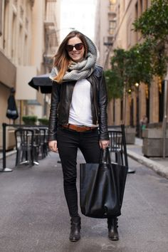 So chic.....LOVE the oversized black bag and brown accent belt.