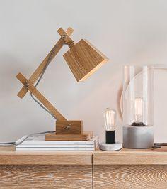 The Beacon Lighting Norway Scandinavian inspired adjustable 1 light table lamp in teak.