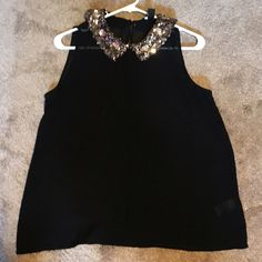 Sexy Sparkly Top Black sheer tank top with a gorgeous gold multi sized sequin collar that features some flower designs to give it a little more pop. Peep hole in back with button for a better fit. Looks great with a pair of jeans or a quick skirt. Forever 21 Tops Tank Tops
