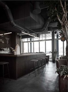 """Danish practice Norm Architects used a palette of dark and warm materials combined with minimal tube lighting to create an """"intimate and cosy atmosphere"""" at this wine bar and restaurant in Copenhagen. Wine Bar Restaurant, Restaurant Design, Restaurant Interiors, Loft Interior, Interior Design, Bar Design, Loft Design, Contemporary Building, Bar Chairs"""