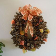 DIY Pine Cone Wreath Using Chicken Wire-a great approach with an easy to understand tutorial the while way through, plus you can use those pine cones all over your lawn! (Debug them, she tells you how! :) )