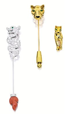 THREE DIAMOND & GEM-SET PINS, CARTIER.  The first jabot pin modelled as a dragon, embellished by brilliant-cut diamonds, accented by circular-cut emerald-set eyes, completed by a terminal set with carved coral, mounted in 18 karat white gold, signed; the second jabot pin modelled as a panther, the eyes accented with pear-shaped emeralds, highlighted by a nose set with calibré-cut onyx;  a matching pin; mounted in 18 karat yellow gold, signed