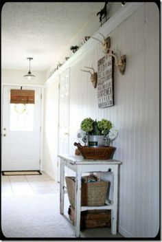 love this idea -a ledge or shelf runs the entire length;height is just over the doors