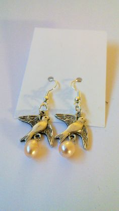 Bird earrings with freshwater pearls.
