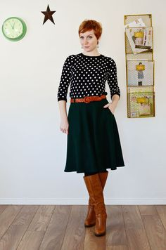 Black midi swing skirt with red belt, black and white polka dot blouse, brown boots. Chic styling!