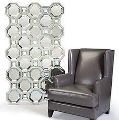 The Axis mirror is that touch of luxury and glamour that a room needs to stand out. It's a chic accent piece and would make an exquisite focal point in any room. The mirror is actually made of several mirrors. It incorporates a total of 15 large octagonal mirrors. They all have deeply beveled mirrored sides and they are interspersed with smaller open squares for a more dramatic effect.