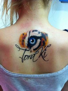 tiger eye tat...Im in love and will copy this (minus the name)