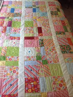 Just finished!  Fun, colorful floral twin quilt perfect for the finishing touch of a cheerful bedroom.
