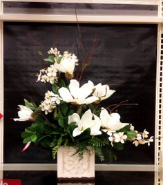 White magnolias , greenery and branches ... arrangement ..