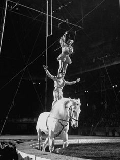 A bareback riding team featuring acrobatics of one sort or another.Sometimes a very difficult move such as a double or triple somersault is done.