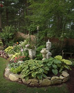 Shade garden - I really like the stone edging!