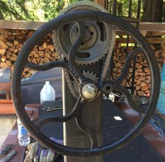 Santa Maria style mechanism for raising the cooking surface. The chain drive is a chevy timing chain and sprockets. The wheel is off an antique Singer sewing machine