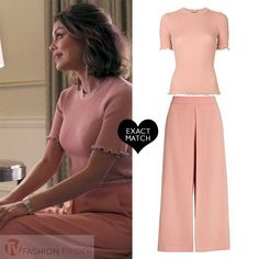 Nathalie Kelley as Cristal Flores in pink top and pink culottes on Dynasty season 1
