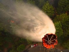 U.S. Airmen with the 129th Rescue Wing, California Air National Guard drop water on the Rim Fire near Yosemite, Calif., Aug. 26, 2013 130826-Z-ZZ999-004 - Aerial firefighting - Wikipedia