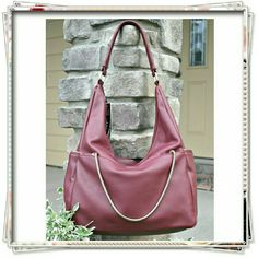 """👜 JustFab Token shoulder bag in wine, bourdoux. 🌟The top of the bag has a zipper, while the front pockets include an additional chain for extra chic space, chain opens two front pockets. Two side pockets decorated with exposed zipper. 3 inside pockets, one with a zip. Light gold hardware  🌟Details: 16""""L x 12""""H x 6""""W, shoulder drop measurement 13"""",  faux Leather, top zip closure.  🌟Please use only ✔OFFER 👈🔴 button for all price negotiations. I'll do 👉🍓a price drop⤵ for you for…"""