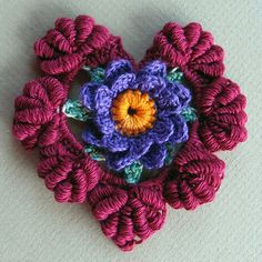Floral fantasy crocheted heart,that would make a pretty pendant!... Free pattern!