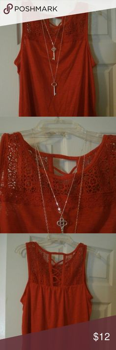 FREE SHIP TODAY ONLY Christmas Red Sleeveless top Vibrant red top, sleeveless with crochet detailing on the front and lattice detailing on the back   3x host pick  FOR FREE SHIPPING  OFFER $6 LESS & I will accept (today only) Or ADD TO BUNDLE for a free shipping offer (today only) Tops Tank Tops