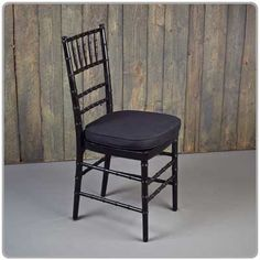 Black Chiavari Chair -- Shown with a tie-on chair pad available in black, white and ivory - order separately. Micro suede or Topaz seat pad covers also available separately.