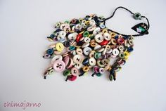 cascade button bib necklace. i've got hundreds of buttons i've been saving for something... maybe a toned down version of this?