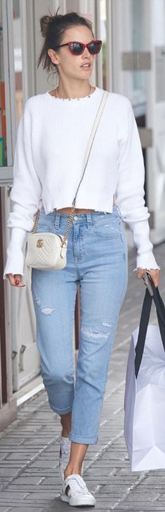 Who made  Alessandra Ambrosio's quilted handbag, star mule shoes, and ribbed sweater?