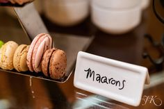 At a recent social event at The Ritz-Carlton, Denver, food descriptions were hand-written in a playful font with a thin permanent marker, directly onto a ceramic label. This spin on the classic paper menu cards creates a more personal touch on the overall presentation.