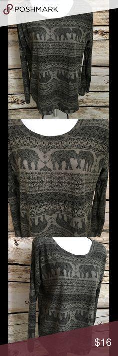 "Rue21 Size Large Women's T-Shirt Elephants Rue21 Size Large Women's Gray T-Shirt Long Sleeve Elephants Asymmetrical hem (slightly longer in back) Lightweight 92% Polyester / 8% Spandex Chest - 24"" (doubled 48"") Shoulders - 26"" Length (down back) - 26"" Rue21 Tops"