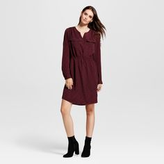 Dress up your wardrobe in versatile fashion with the Printed Convertible-Sleeve Shirtdress from Xhilaration™. This burgundy A-line dress has a flowy crepe construction that keeps things easy, while the subtle print, front pockets and long sleeves dress things up a bit. Whether you pair this with tights and ballet flats for a day at work or with booties for a night out with friends, you'll be feeling as great as you look.