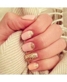 Light pink nails with half moon gold glitter and a gold glitter accent nail