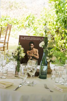 Use some of your favorite old records to decorate your reception tables like this couple did in these wedding photos below taken by Karen Loudon Photography. What a fun idea!