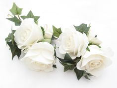 Corsages of soft white fresh touch roses and ivy. Find your perfect wedding flowers at www.loveflowers.com.au