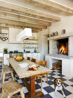 Gorgeous bright kitchen with a rustic feel.. the brick oven fireplace is love <3....
