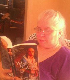 Thank you to Linda Marie Finn for this picture of her reading my new release!