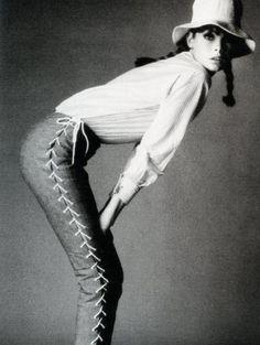 Jean Shrimpton. Laced up pants, white shirt, braids