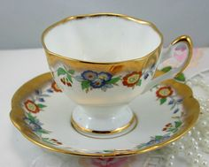 Lovely, Floral Pattern. Gold Rich Teacup & Saucer, Fine Bone English China made in 1970s. In good condition, no chips, cracks, crazing or repairs. The Saucer measures-5.7 (14.5cm) in diameter. The Cup opening-3.5 (9cm), with the handle-4.3 (11cm) The Height-2.7 (7cm)