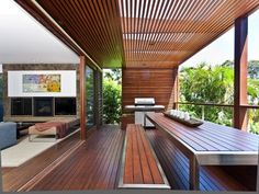 Love the seamless flow of the living room onto the deck and great use of timber particularly the ceiling/roofing.
