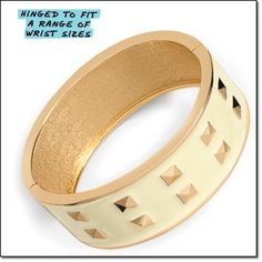 """mark. HIGHLY DECORATED BRACELET • Show your style-overachiever status with this bangle, featuring rows of shiny pyramid studs """"set"""" in sleek cream-colored enamel http://jgoertzen.avonrepresentative.com/"""