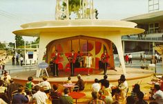 """A futuristic garden becomes a rising stage for Tomorrowland entertainment"" in a 1967 Disneyland Postcard Folder 