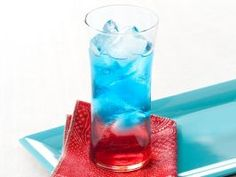 Guy's Fourth of July Cocktail : Guy fills half a glass with cranberry juice mixed with watermelon schnapps and then carefully pours a tequila-blue curacao combo over the red layer. How patriotic! Once you start sipping, it's bound to turn purple, but it will still taste delicious.