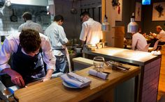 Day 480 of 'A Photograph Every Day For The Rest Of My Life' Wednesday 16th November 2016 I spent my usual Wednesday afternoon at Isaac's www.isaac-at.com and just before I left I took this photograph of the Chefs. The restaurant has seats in the main area, plus it has two special seats which you can see in the foreground of this photograph. This is the 'Table By The Pass' which gives two guests the chance to have a more immersive experience, with a direct view into the kitchen…