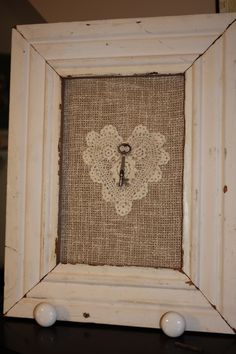 Reclaimed wood frame with crocheted heart and key
