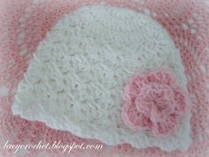 Just made a similar one using one of my recently pinned baby hat patterns, and I added one of my roses to it. Came out SO pretty if I do say so myself! ;)   ***       Very pretty newborn hat. See the link to free pattern in the post.